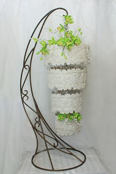 Green Orchids - a hanging wedding cake by Marina Danovska - http://cakesdecor.com/cakes/206545-green-orchids-a-hanging-wedding-cake