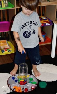 Dropping Lids into Container ~ Tot Tray {37 months}