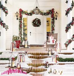 Love the outdoor Christmas garland around the door.
