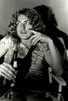 Robert Plant enjoys a beer backstage at a birthday party for John Bonham in 1969.