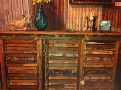 This would be an awesome shutter wine cabinet ... vintage shutter doors with some vintage wine