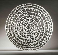 "Barbro Aberg. ""Spiral Wheel."" 2005.   Paper clay"