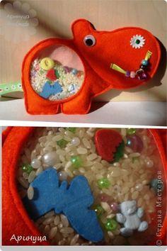špionážní taška - tato taška s korálky, korálky z polypropylenu nebo zrnek, ve směsi s malými hračkami, a kteří potřebují najít, posunutím výplň.  Mohou být vidět přes průhledné okénko.  Hračka je určena pro děti 3-4 roky, rozvíjí jemnou motoriku rukou, myšlení, dobré pro nervový systém.  foto 2