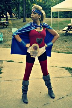 """Gut Girl"" This is my super hero alter-ego. She has an ostomy pouch full of glitter, a colon headband, and is Inflamed and Untamed! Ready to fight Crohn's disease and ulcerative colitis. :) (Me in my super hero costume at camp oasis) http://www.inflamed-and-untamed.com/"