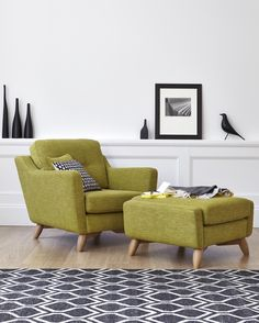 The Cosenza is a stylish upholstery collection with strong retro undertones, it displays signature ercol features such as solid oak turned legs. Ercol Furniture, Home Furniture, Furniture Design, Furniture Upholstery, Retro Armchair, Green Sofa, White Rug, White Walls, Black White