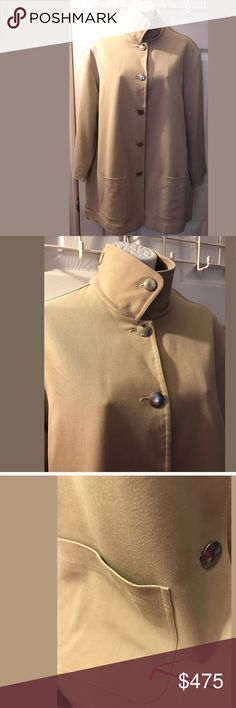 """Vtg CHANEL Car Coat Jacket Khaki Tan Wool Blends This is a stunning vintage Chanel car coat or jacket. It has a khaki tan wool blend material, Full length Chanel buttons, bracelet length sleeves and is lined. It has a few faint marks as shown in the last picture, none of them are super noticeable. It is missing the size tag so please refer to measurements for fit. This is a stunning timeless piece!  Chest flat: 23"""" Sleeve: 20"""" Total length: 30"""" Bin C  Please let me know if you have any…"""