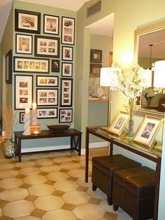 This entryway is just beautiful! From the floors, to the wall color, to the accessories, down to the family photos. This is a beautiful way to make a statement of what matters most at the entrance of your home! Use collage photo frames mixed with other single frame sizes to get this look and space each frame about 2 inches apart!