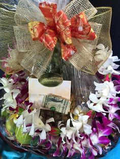 Hawaiian basket w/fresh leis. A great way to say: Congratulations and Welcome
