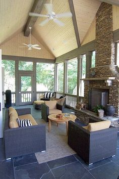 the perfect porch ... love the peaked roof with wood planks and contrasting beams