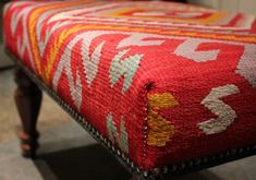 Rug Covered Ottomans | love those beautiful stained legs and the nailhead trim