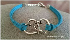 Check out this item in my Etsy shop https://www.etsy.com/listing/225001870/double-heart-blue-suede-bracelet