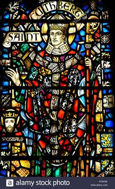 Saint Cuthbert stained glass window in  St Thomas Church Fifth Avenue New York USA Stock Photo