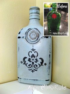 Old gin bottle painted it with spray first…Oil Rubbed Bronze and Annie Sloan Chalk Paint…added a stencil, waxed & distressed it.