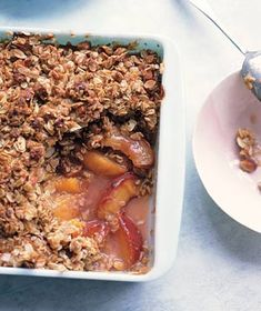 Peach Crisp|A crunchy, nutty topping turns juicy peaches into a satisfying end-of-summer dessert.