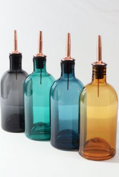 What better way to make your kitchen basics feel special than with a hand-blown glass oil and vinegar bottles. Simple, elegant and timeless, just perfect in size so it holds enough but stays easy to manipulate. These would make a perfect housewarming gift for a new homeowner. Kitchen Must Haves, Kitchen Ideas, Oil Bottle, Water Bottle, Cocktail Mix, New Homeowner, Hand Blown Glass, Vinegar, House Warming