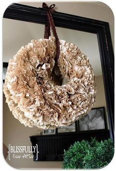 DIY wreath made out of coffee filters.  I have made two of these.