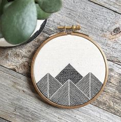 Stephanie Lapre: Stephanie's embroidery work more often than not revolves around mountainous geometric shapes.