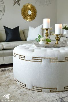 Elegant Uphostered Ottoman with Gold Nailhead Trim para el hogar Decor, Upholstered Ottoman, Interior, Diy Furniture, Home Furniture, Ottoman Decor, Tire Furniture, Trending Decor, Home Decor Furniture
