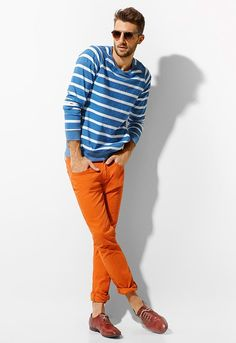 Below: Coloured jeans are a great way to get on the colour blocking trend for Spring Summer 2011. Shown below are Zara's SS2011 lookbook featuring coloured jeans from orange to yellow to reds (SGD 89.90)! I love this first look with a light blue stripe L/S sweater... Nautical colour blocking?