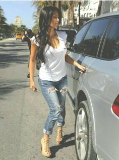 Ripped jeans with simple white T and booties.. #perfect #simple #dayout
