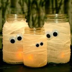 Easy DIY halloween craft  Wrap jars in gauze and attach googly eyes!  This will be great with the solar lids!!!  I'm getting out the gauze!!