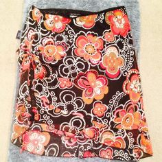 Flower Power Skirt 🎉 HP - Wardrobe Refresh Party 02/17/16 🎉 Top Trends Party 04/01/16 🎉 Best in Dresses & Skirts Party 10/07/16 🎉 Excellent Condition | Never Worn | Flower Design | Browns, Reds, & Oranges | Black Lining | Tie on Left Side | Ruffle Tier on Bottom | Stretchy | 100% Polyester |🚫 Trades | Feel Free to Ask Questions 🙋| More 📷 Upon Request | Bundles & Offers are Welcomed ❤️| Script Skirts Asymmetrical