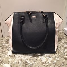 Kate Spade satchel Black with white sides Kate Spade large satchel. No obvious signs of wear and tear. Just a very small pen mark on the side which can most likely be removed. Comes with the original dust bag.  Bundles save Make an offer  No trades  kate spade Bags Satchels