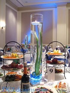 calla lillies in tall glass with candle | ... calla lily centerpiece modern tall glass design blue wedding flowers