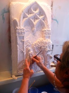 Plaster high relief panel.
