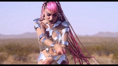Grimes - Genesis  Snapbacks and samurai swords, pink braids and huge flatforms. Need I say anymore? I LOVE the theme and styling of this music video and the location fits. So weird but I'm so drawn to it!