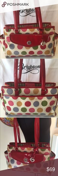 ⭐️BRIGHTON SHOULDER BAG 💯AUTHENTIC BRIGHTON SHOULDER BAG 100% AUTHENTIC. SO PRETTY AND STYLISH. CHEERFUL AND WONDERFUL BAG. THIS IS A ROOMY BAG WITH LOTS OF EXTRAS. THIS WONDERFUL BAG HAS FOUR OUTSIDE POCKETS . IT ALSO HAS THREE INTERIOR MAIN COMPARTMENTS . ONE OF WHICH IS A ZIP TOP. THE BAG ALSO HAS THREE INTERIOR WALL POCKETS. THE BAG MEASURES 12 INCHES WIDE BY 8 INCHES TALL. IT DOES HAVE A BIT OF EXTERIOR SMUDGING BUT IT IS STILL A LOVELY BAG. THE GENEROUS SHOULDER STRAPS HAVE A 13 INCH…