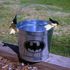 Batman Easter Basket, could be used for Halloween too. Can paint, monogram, draw, design bucket many other ways too. Maybe add a lining on the inside!