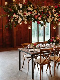 pink and white rustic reception setting hanging floral installation   Photography: Karen Hill Photography