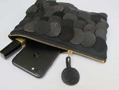 opulent clutch or toiletry bag for your small things like phone, keys and makeup etc. it is made of very soft alcantara (ultrasuede) that is hard to tell apart from real suede. differently...