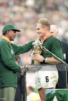 Francois Pienaar of South Africa receives the William Webb Ellis Trophy from President Nelson Mandela 1995