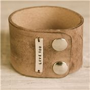 Cuff. cute :) similar to what im getting for me and the hubby :) i like this color leather
