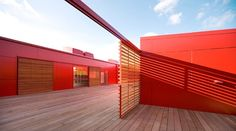 Kindergarten in Denmark features bold red with natural wood.