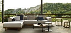 The Vis à vis sofa from Tribù, is an exclusive outdoor lounge sofa in teak wood with outdoor cushions placed on invisible brackets
