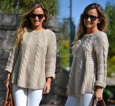 Стильная туника или удлиненный пуловер, связанный спицами.
