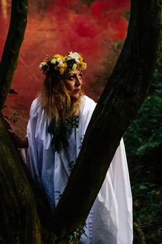 Coloured smoke bomb grenades portrait creative photography. The goddess in the woods.