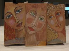 brown bag portraits...like the idea of using the brown paper and creating the skin tones from that