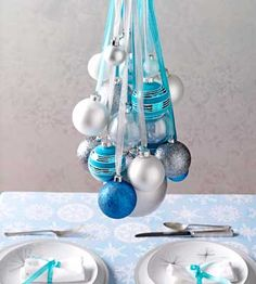 Ornaments hung together on ribbons make a colorful cascade. Hang them from a light fixture or hook.