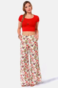 Check it out from Lulus.com! Be a pansy . . .  in a good way! With the bold floral print of the What in Carnation Wide-Leg Cream Floral Print Pants, your fabulous fashion sense will be the talk of the town! These bright floral pants with a cream backdrop have the high-waisted appeal that everyone is looking for. Woven fabric starts at a beautiful banded waist and front pockets before flowing into a winsome wide-leg cut. Hidden back zipper. Shorts-length lining; legs are sheer. Model is…
