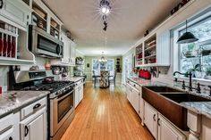 Traditional Kitchen with Farmhouse sink, Subway Tile, Pendant light, U-shaped, Harney Hardware 36240 Cabinet Pull