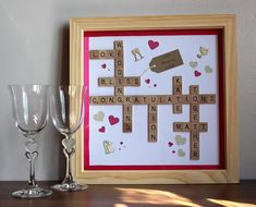 Add names and date. Choose wedding colour scheme. Large frame (12 inch square) Frame available in natural wood, antique wood, black or white.