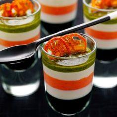 verrine of layered blushed tomato, boccocini mozzarella and pesto, drizzled with olive oil