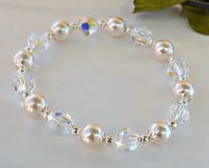 A personal favorite from my Etsy shop https://www.etsy.com/listing/260994135/swarovski-crystal-and-pearl-stretch