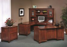 My husband and I are looking to find some new office furniture. I love the traditional look of this beautiful wood furniture. The dark color would look great with our blue walls.