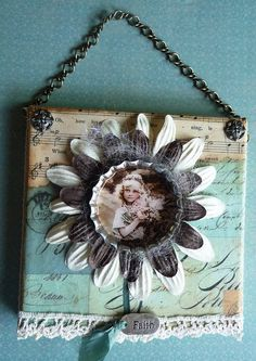 like the use of the chain and upholstery tacks plus the bottle cap and flower