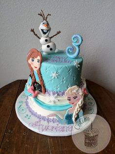Disney Frozen theme cake. Anna, Elsa, and olaf fondant pieces. Olaf sculpted. Two tiered birthday cake. Snowflakes. Frozen birthday cake